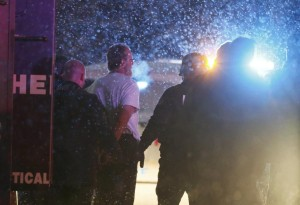 A suspect is taken into custody outside a Planned Parenthood center in Colorado Springs, Colorado November 27, 2015. Police arrested a gunman who stormed the Planned Parenthood abortion clinic in Colorado Springs on Friday and opened fire with a rifle in a burst of violence that left at least 11 people injured, including five officers, authorities said.  REUTERS/Isaiah J. Downing   FOR EDITORIAL USE ONLY. NO RESALES. NO ARCHIVE.             TPX IMAGES OF THE DAY